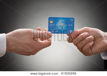 Businesspeople Hands With Credit Card