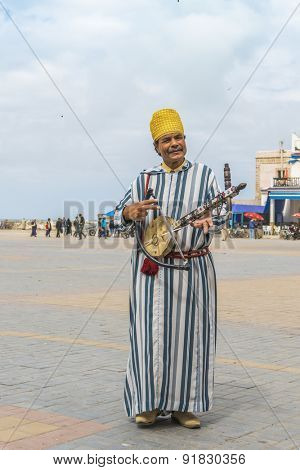 AS-SAWIRA, MOROCCO, APRIL 7, 2015: Man plays traditional Berber instrument