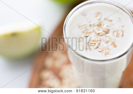 food, healthy eating and diet concept - close up of yogurt with oat flakes