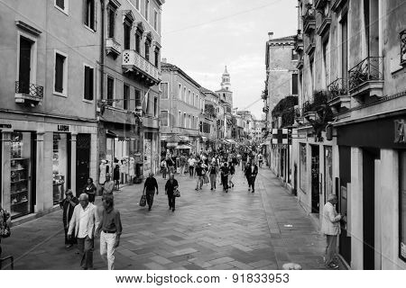 VENICE - SEP 14: streets of Venice on September 14, 2014 in Venice, Italy. Venice is a city in northeastern Italy sited on a group of 118 small islands separated by canals and linked by bridges