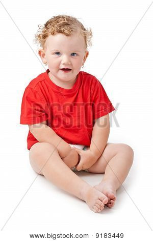 Baby girl sitting on floor isolated on white