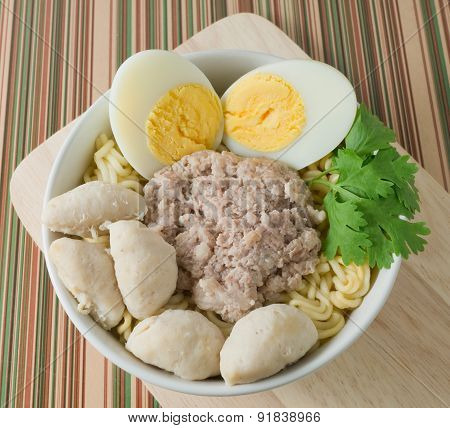 A Bowl Of Instant Noodles With Meat Ball And Boiled Egg