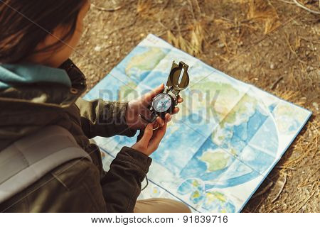 Female Traveler With A Compass And Map