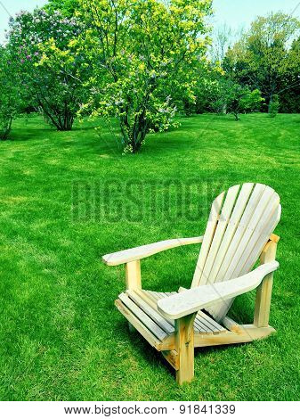 Wooden Chair In Spring Garden