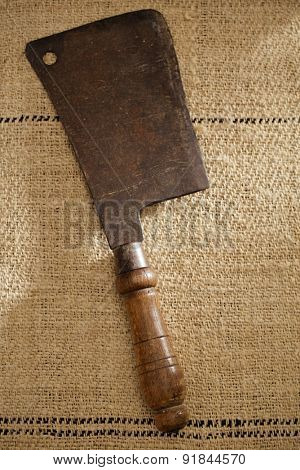 real vintage wooden and iron meat cleaver on old grain sacking linen Completely hand made  handwoven and homespun