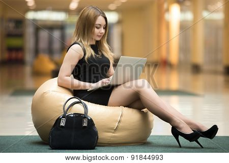 Young Woman With Laptop In Public Wifi Area