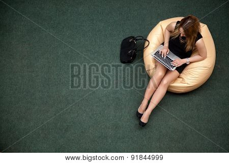 Young Woman Working On Laptop, Top View