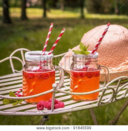 Relaxing in summer with raspberry fruit drinks - square format