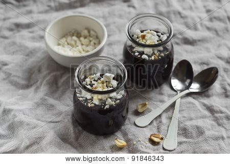 Chocolate Pudding With Meringue Crumbs And Nuts In A Vintage Style