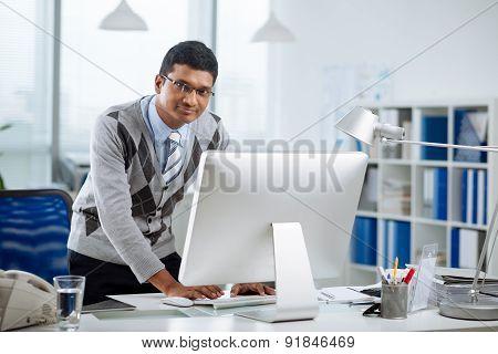 Smiling Indian programmer