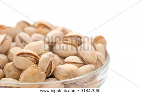 Pistachio Nuts In A Glass Bowl Close Up With Clipping Path