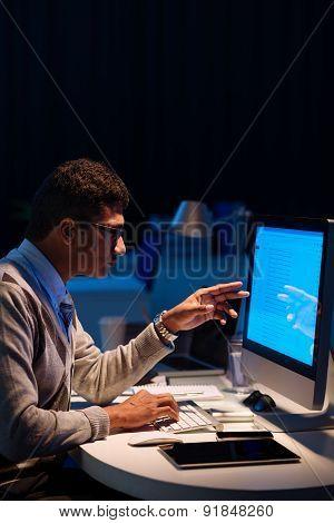 Pointing at computer monitor