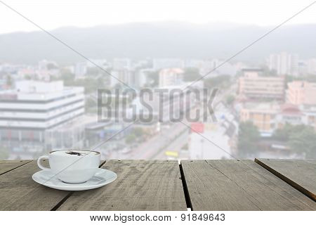 Terrace Wood And Cappuccino Coffee With Chiangmai City Backgroun