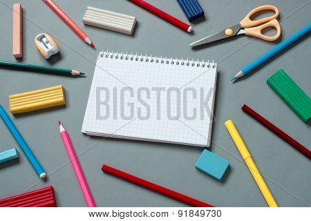 Colorful School Supplies Scattered Around Notebook