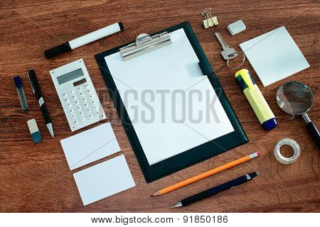 Office Supplies Arranged Around Clipboard On Desk