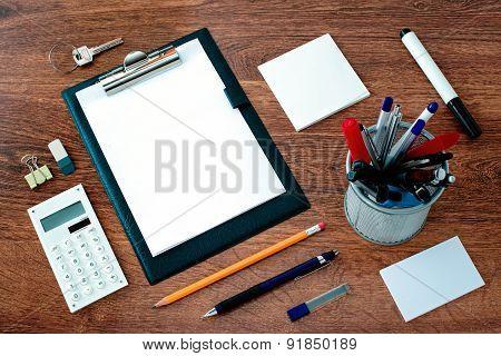 Office Supplies Arranged Around Clipboard On Desk