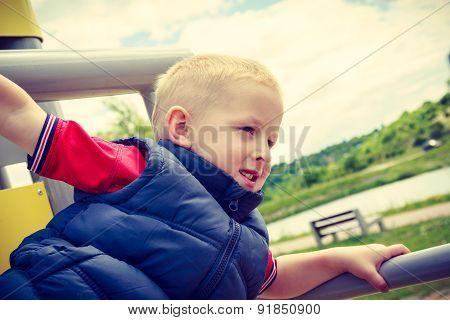 Active Child Kid Having Fun In Playground.