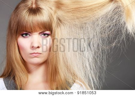 Blonde Woman With Her Damaged Dry Hair.