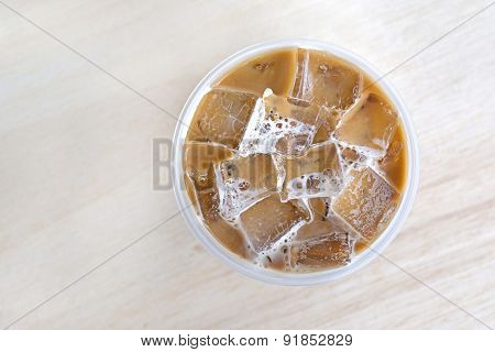 Top View Cold Coffee Drink With Ice On Old Wood Table