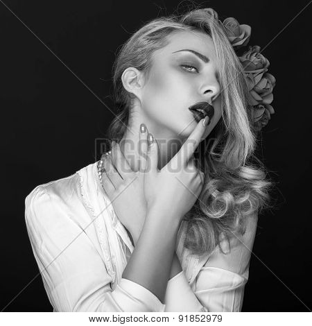 Beautiful Woman With Flowers In Head And Finger On Lips