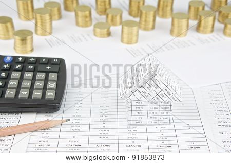 House With Pencil And Calculator Have Gold Coins As Background