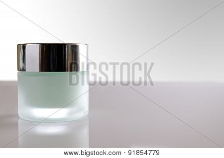 Cream Jar Closed On Glass Table