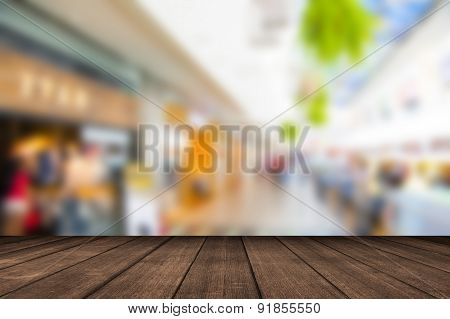 Empty wood table top with coffee shop blur with bokeh backgroundProduct display template.