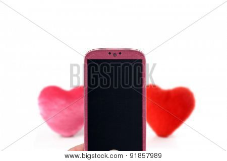 Smatrphone and hearts. Idea for lovelly message, matching, dating chat, celebrating Valentine's Day, Mother's Day, father's day, love apps, accessing apps, Internet, blogs and others.