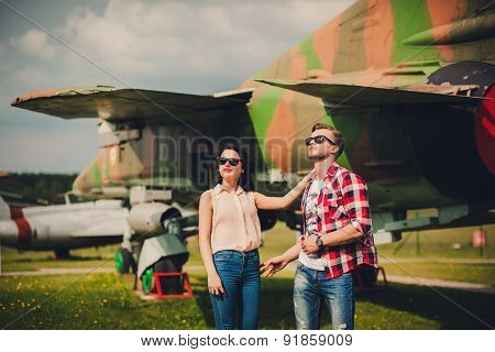 Fashionable Couple Walking On The Airfield