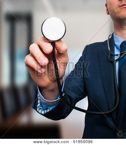 Business man with stethoscope. Business health