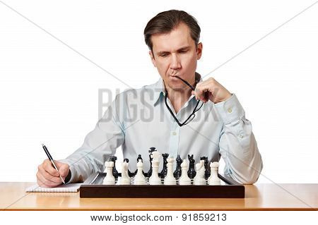 Man With Glasses Playing Chess Isolated