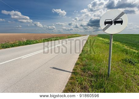 Driving On An Empty Road And Sign At Sunny Day