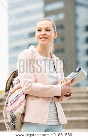 Young female student at college campus
