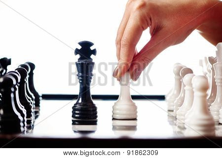 Hand With White Pawn Moves To Black King