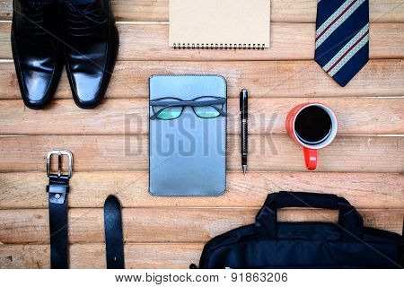 Cup Of Coffee And Men Accessories On Old Wooden Background