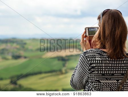 Tourist Photographs The Tuscan Hills With Compact Camera
