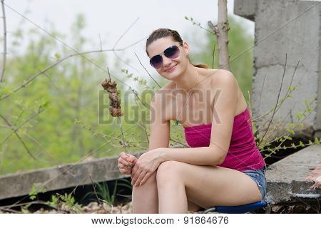 Young Girl With A Skewer And Barbecue