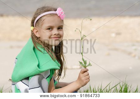 Girl With Blade Of Grass In Hands