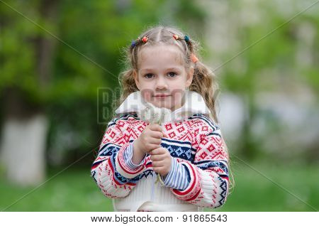 Portrait Four-year Girl With Bouquet White Dandelions In The Hands Of