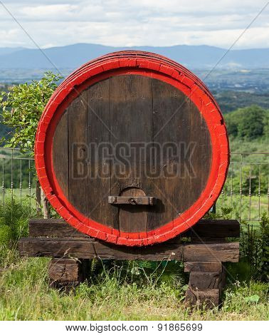 Wooden Barrel For Wine Placed In Outdoor Field