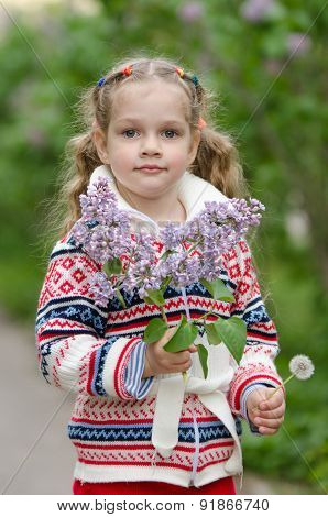 Portrait Of Girl With Lilacs And Dandelions In The Hands