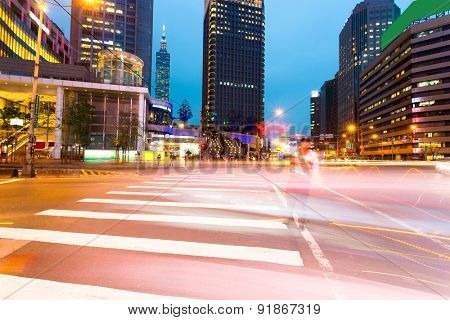 light trails in modern city street