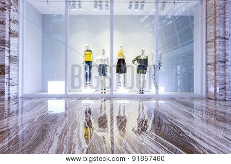 mannequins in fashion shop display window