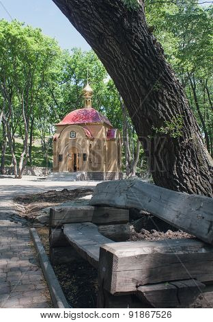 Chapel And A Bench In The Park. Dzerzhinsk, Ukraine