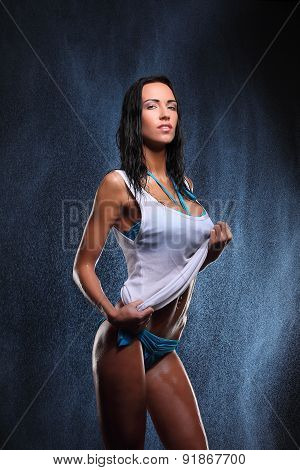 Young sexy woman posed wet. Water studio photo. fresh