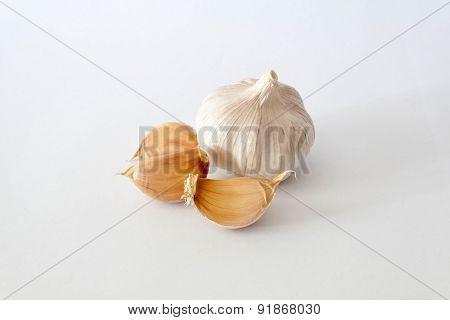 Bulbs Of Garlics On White Background.