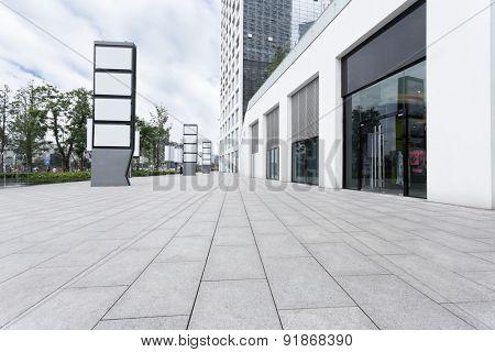 Empty road near modern building