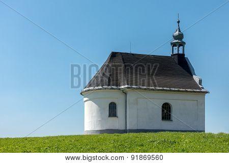 Rural Baroque Chapel On The Horizon