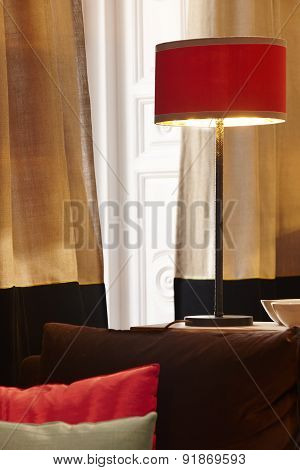 Home Interior With Red Lamp And Window With Curtains