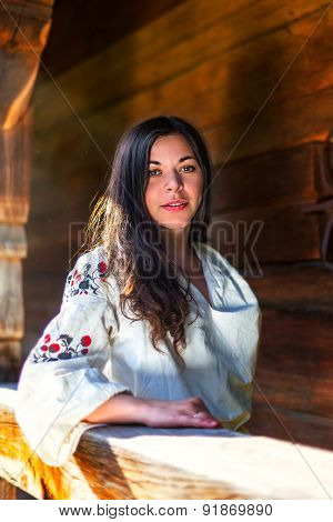 Woman In Ukrainian National Costume At The Sun-parlour